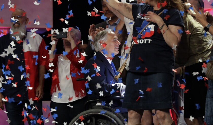 Texas Gov. Greg Abbott greets supporters at the state GOP convention in San Antonio in June 2018.