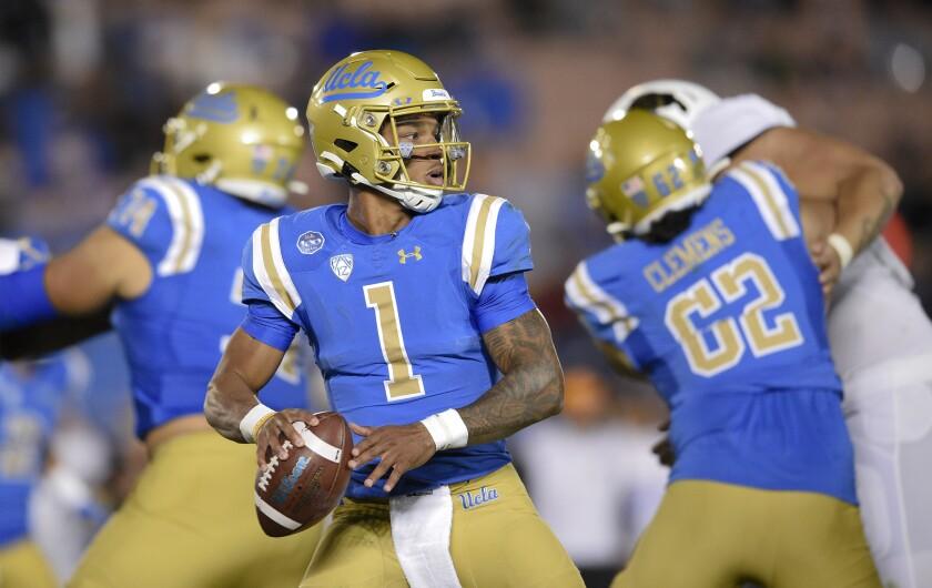 UCLA quarterback Dorian Thompson-Robinson looks to pass against Colorado on Nov. 2, 2019. UCLA won 31-14.