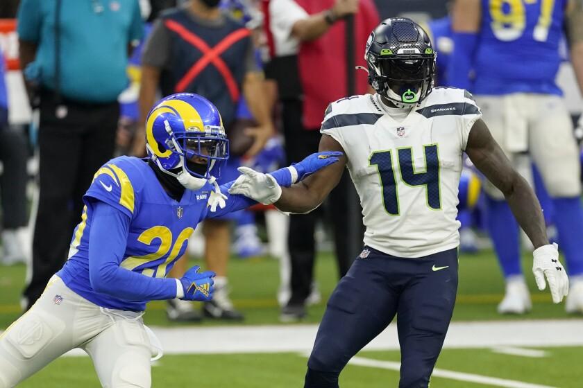 Seattle Seahawks wide receiver DK Metcalf is defended by Rams cornerback Jalen Ramsey.