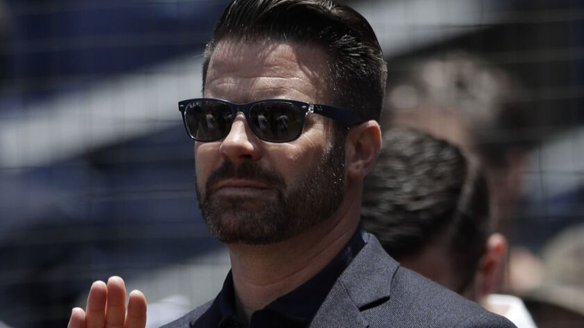 Erik Greupner, San Diego Padres chief operating officer, looks on before a baseball game between the