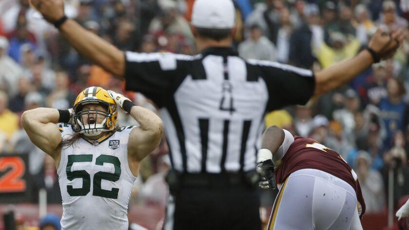Green Bay Packers linebacker Clay Matthews (52) reacts to his penalty after tackling Washington Reds