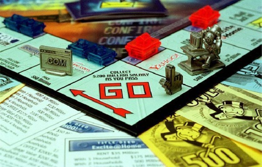 Many versions of Monopoly have been devised since the  introduction of the popular board game, including this set  that features properties such as Yahoo. (Associated Press)
