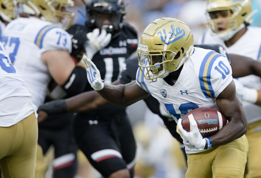 UCLA running back Demetric Felton carries the ball during the first half of the Bruins' 24-14 season-opening loss to Cincinnati on Thursday.