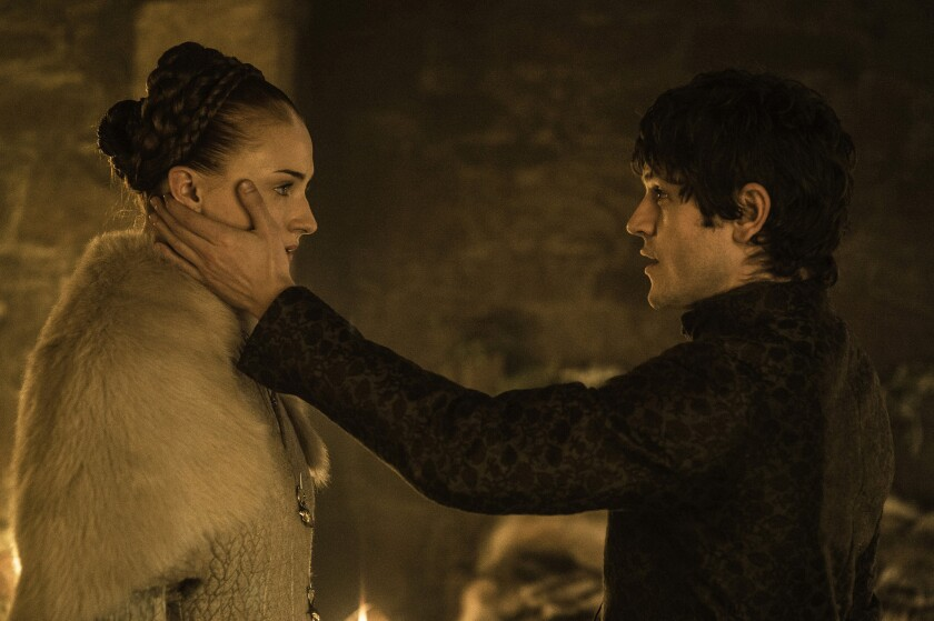 "Sophie Turner as Sansa Stark and Iwan Rheon as Ramsay Bolton in ""Game of Thrones."""