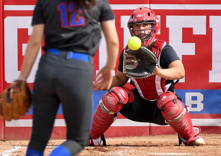 Los Alamitos catcher Sophia Nugent warms up before a game.