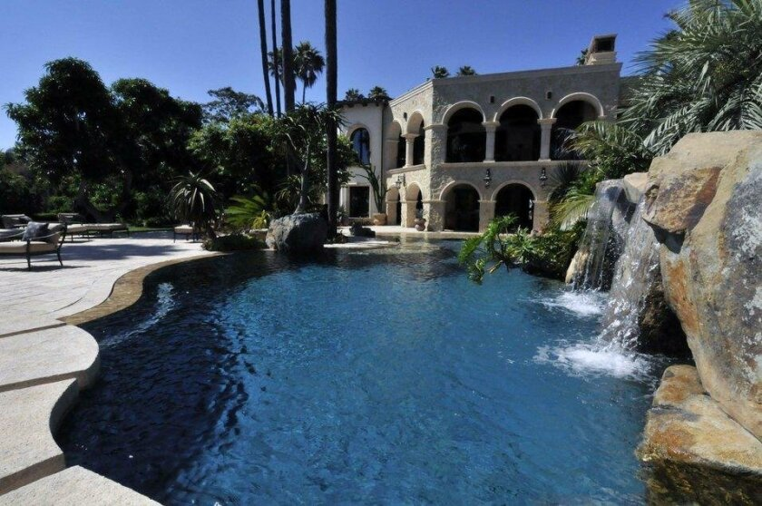 The one-of-a-kind estate is located on more than six acres and surrounded by ocean views and lush grounds.