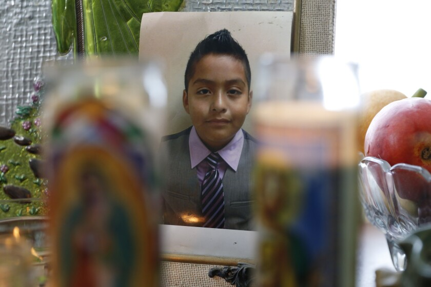 A memorial set up for Jesse Romero in his mother's home in Boyle Heights.
