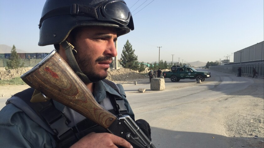 An Afghan police officer near the scene of an attack in Kabul, Afghanistan.
