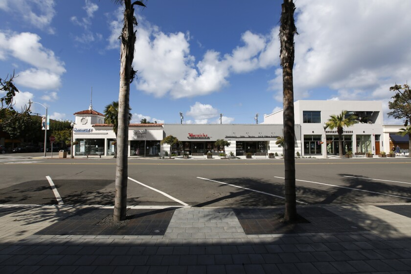 The normally busy Girard Aveve in La Jolla Village was cleared out in March by the pandemic shutdown.