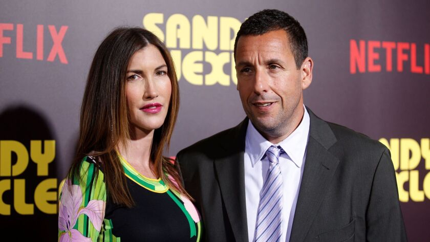 """Actor Adam Sandler (R) and his wife Jackie (L) pose at a premiere for the Netflix original film """"San"""