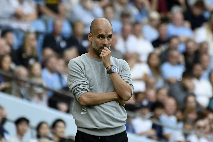 Manchester City's head coach Pep Guardiola watches during the English Premier League soccer match between Manchester City and Southampton at the Etihad Stadium in Manchester, England, Saturday, Sept. 18, 2021. (AP Photo/Rui Vieira)