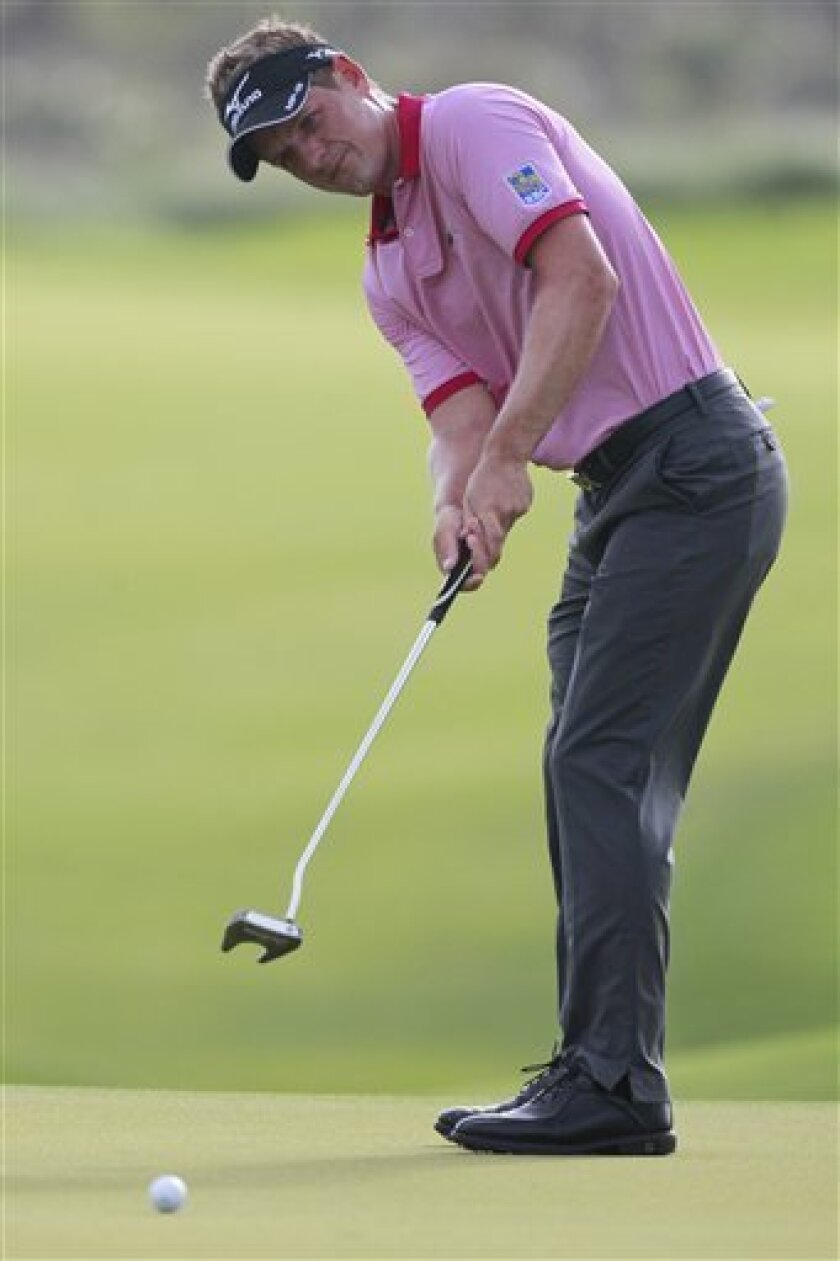 Luke Donald of England putts on the 11th green during the second round of the PGA Championship golf tournament on the Ocean Course of the Kiawah Island Golf Resort in Kiawah Island, S.C., Friday, Aug. 10, 2012. (AP Photo/John Raoux)