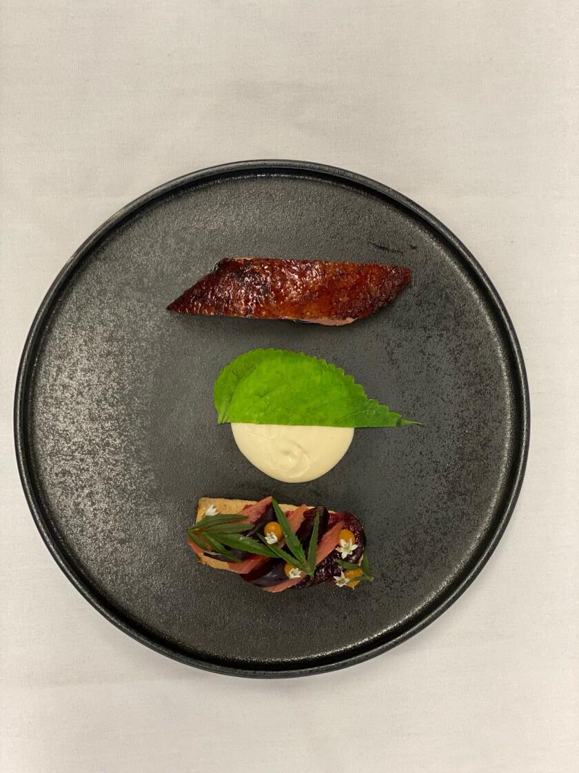 A duck dish from Avant Restaurant's new $135 tasting menu.
