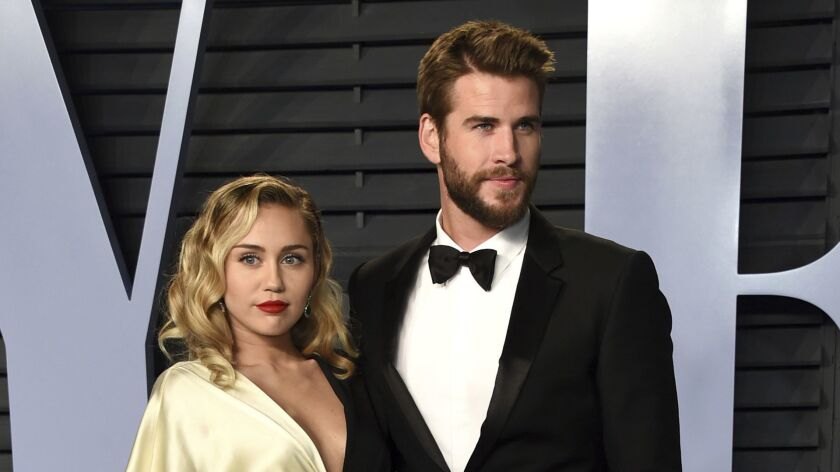 Miley Cyrus and Liam Hemsworth at Vanity Fair's 2018 Oscar party.