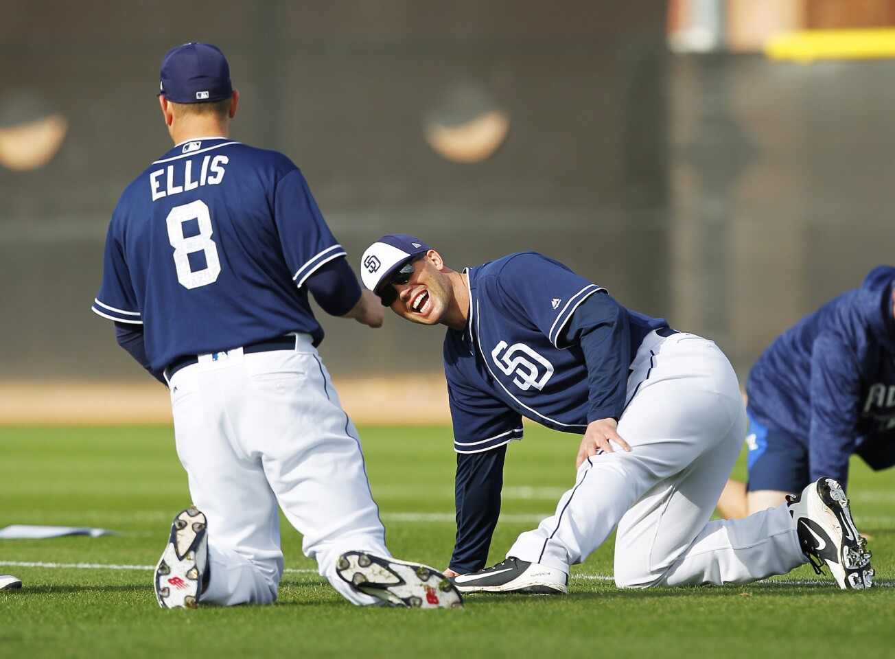 San Diego Padres pitcher Clayton Richard and catcher A.J. Ellis share a laugh during a spring training practice in Peoria on Feb. 19, 2018. (Photo by K.C. Alfred/ San Diego Union -Tribune)