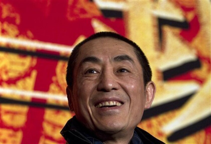 FILE - In this Dec. 22, 2010 file photo, Chinese director Zhang Yimou smiles during a press conference to promote his new movie in Beijing. Media reports circulated online this week that Zhang Yimou, who is also known as the architect of the opening ceremony for the Beijing Olympics, has seven children from his two marriages and from relationships with two other women. (AP Photo/Alexander F. Yuan, File)