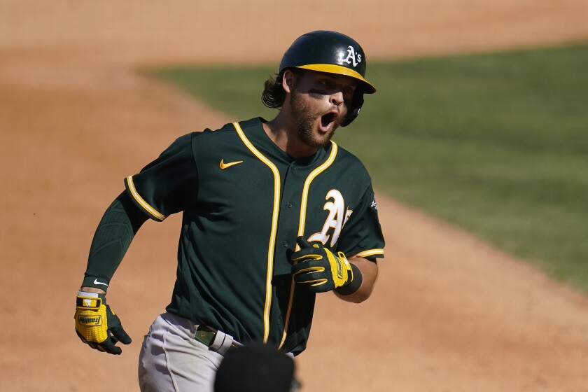 Oakland Athletics' Chad Pinder rounds the bases after hitting a three-run home run.