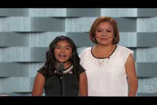 Karla Ortiz, daughter of undocumented parents, speaks with her mother Francisca at the Democratic National Convention