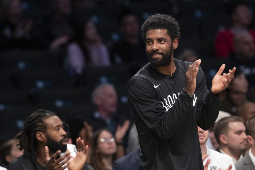 Brooklyn Nets guard Kyrie Irving reacts as he watches the action against the Sesi/Franca Basketball Club from the bench during the first half of a exhibition NBA basketball game, Friday, Oct. 4, 2019, in New York. (AP Photo/Mary Altaffer)