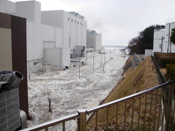 The access road at the Fukushima Daiichi power plant in Japan is flooded after being hit by the devastating March 11 earthquake and tsunami.
