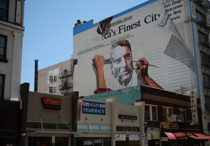 After 25 years, an iconic part of downtown art may come down. The mural depicting a newspaper in the year 2050 can be found off 6th avenue.