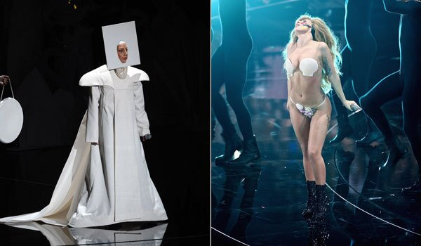 """Lady Gaga kicked things off in customary head-turning fashion with the debut performance of her new single, """"Applause."""" Despite a slow start, she soon kicked things into a higher gear. Though chances are most people will be discussing her multiple costumes changes rather than the actual song. Switching wigs and outfits more often than she changed tempos, Gaga went through a variety of looks before ending up in a string bikini and clamshell top, giving the audience a very brief flash of her bum while twirling on stage. Will that get blurred in subsequent airings?"""