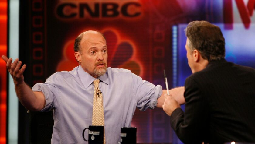 "Jim Cramer, left, host of ""Mad Money"" on CNBC and co-founder of TheStreet Inc., talks with Jon Stewart during an appearance on Comedy Central's ""The Daily Show"" in 2009."
