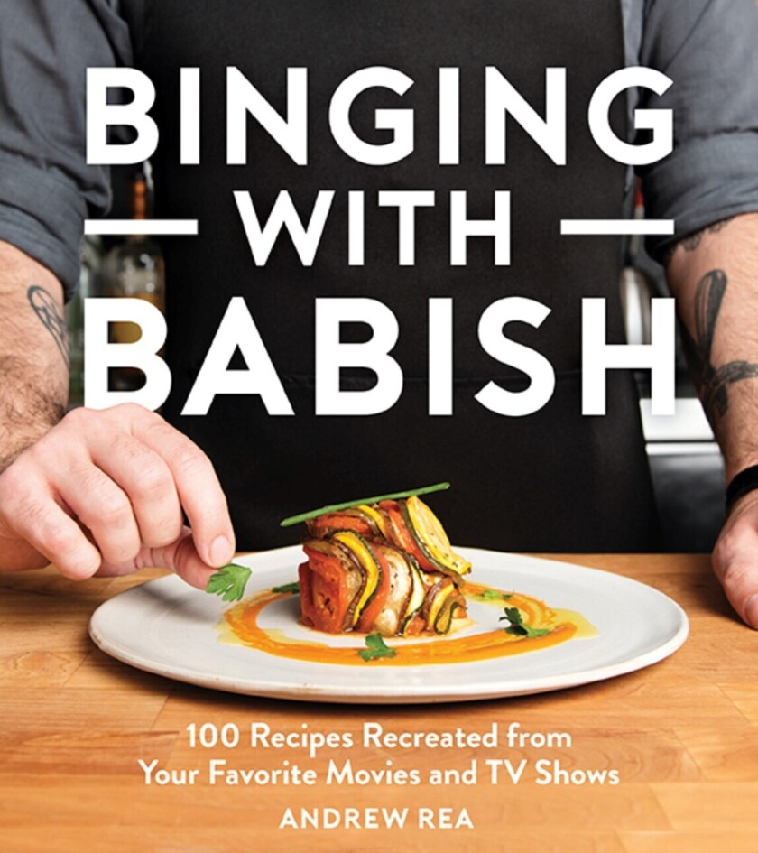 """This cover image released by Houghton Mifflin Harcourt shows """"Binging with Babish: 100 Recipes Recreated from Your Favorite Movies and TV Shows,"""" by Andrew Rea. (Houghton Mifflin Harcourt via AP)"""