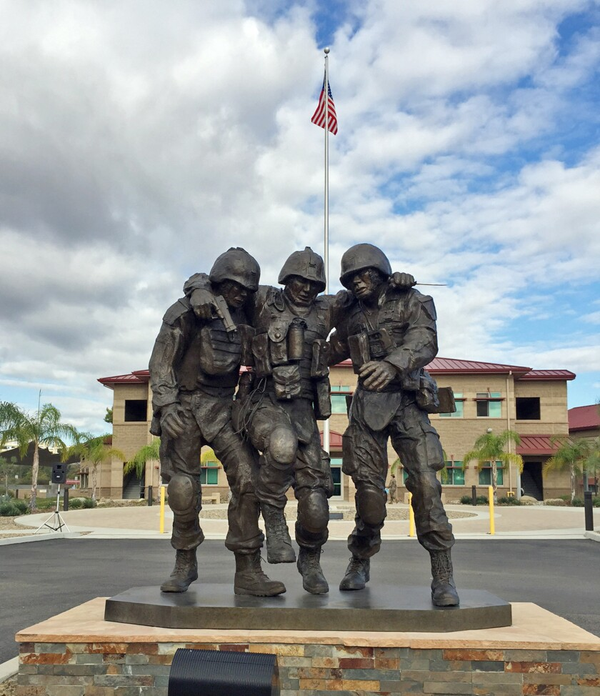 A sculpture unveiled at Camp Pendleton is modeled after an iconic photo taken at the battle in Fallouja, Iraq, in 2004.