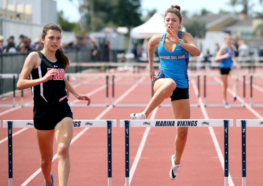 Corona del Mar's Paige Damron finishes in second place behind winner Isabella Ales of Troy in the 300-meter intermediate hurdles event of the Beach Cities Invitational at Huntington Beach High on March 23.