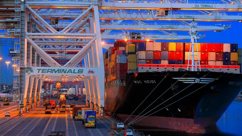 Containers are unloaded from a ship at the Port of Los Angeles. A plan by Southern California air quality regulators relies on voluntary measures for ports, warehouse distribution centers and other freight pollution hubs.