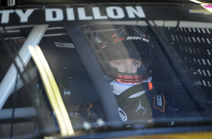 Ty Dillon (14) gets ready to go out on the track during a NASCAR Sprint Cup auto race practice at Atlanta Motor Speedway Saturday, Feb. 27, 2016, in Hampton, Ga. (AP Photo/)