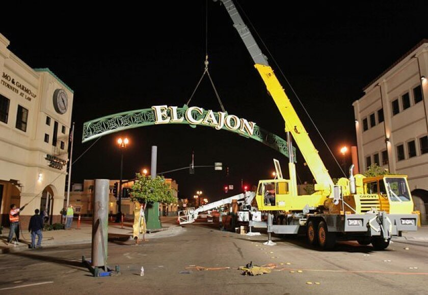 Crane operator Paul Friend lifted the arch in to place. When lighted, the arch will change color depending on the temperature above or below 75 degrees. (James Skovmand / Union-Tribune)