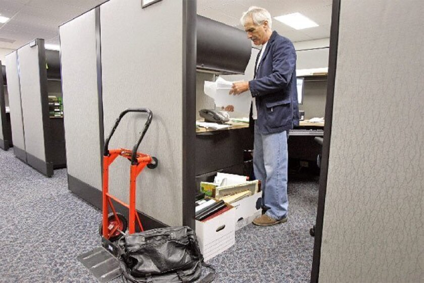 Jim Bliesner cleared out his office yesterday, his last day as director of the San Diego City-County  Reinvestment Task Force. He held the position since 1985. (Eduardo Contreras / Union-Tribune)
