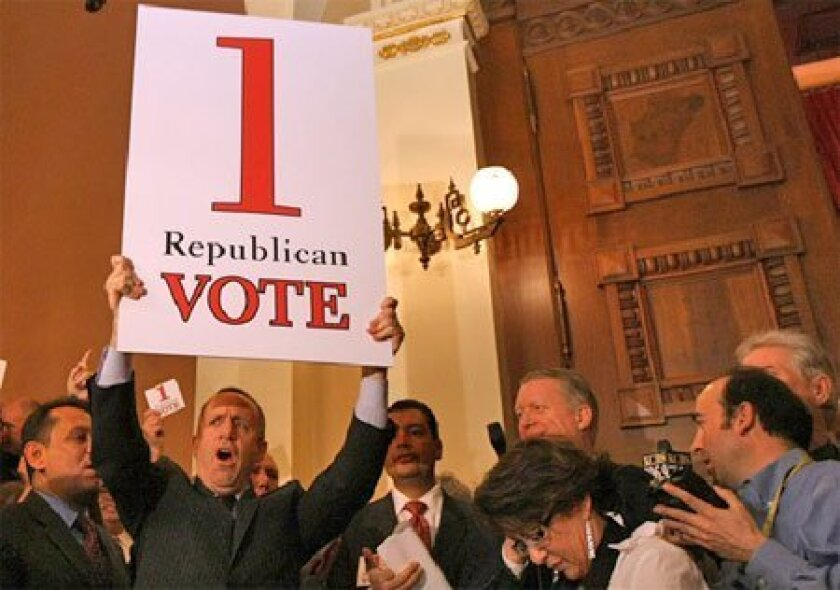 Senate leader Darrell Steinberg held a sign  calling on one more Republican to vote for a  state budget yesterday. (Getty Images)