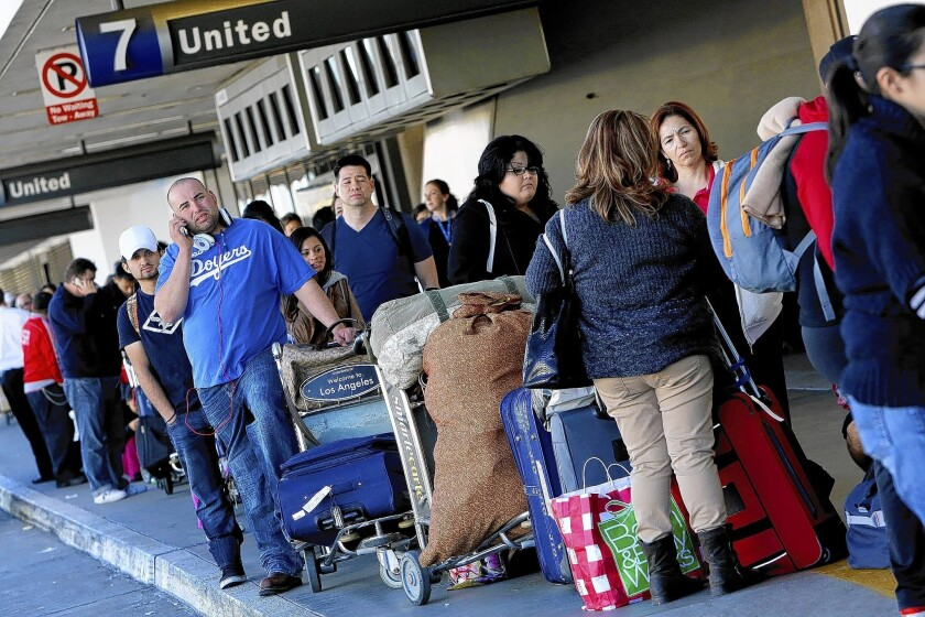 Travelers forced to pay checked-bag fees may not have noticed airlines at the same time lowering ticket fares slightly to help make the extra costs more palatable.