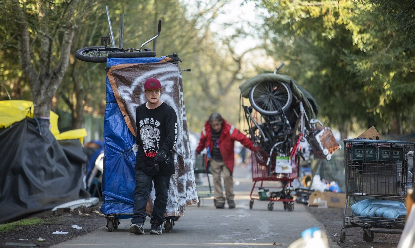 Homeless campers along the Joe Rodota Trail use shopping carts  and improvised dollies to move their belongings in Santa Rosa.