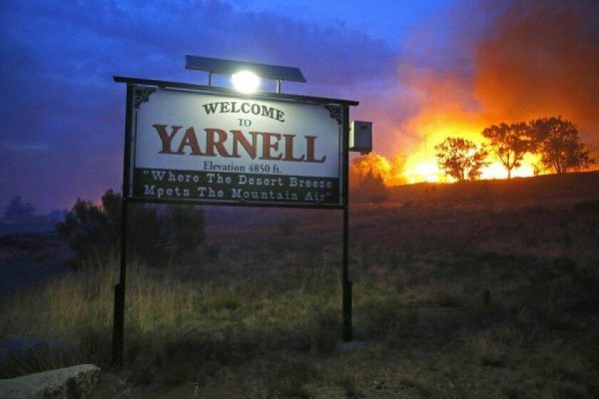 A wildfire burns near Yarnell, Ariz.