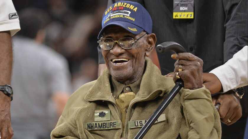 Richard Overton leaves the court ion March 23, 2017, after a special presentation honoring him as the oldest living American war veteran, during an NBA game between the Memphis Grizzlies and the San Antonio Spurs.