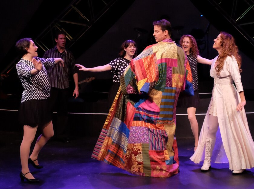 "David S. Humphrey, center, stars in Lamb's Players Theatre's ""Joseph and the Amazing Technicolor Dreamcoat"" at the Horton Grand Theatre in San Diego's Gaslamp Quarter."