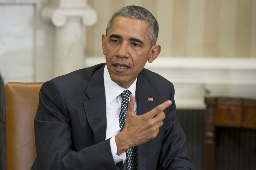 President Obama speaks in the Oval Office on Friday.