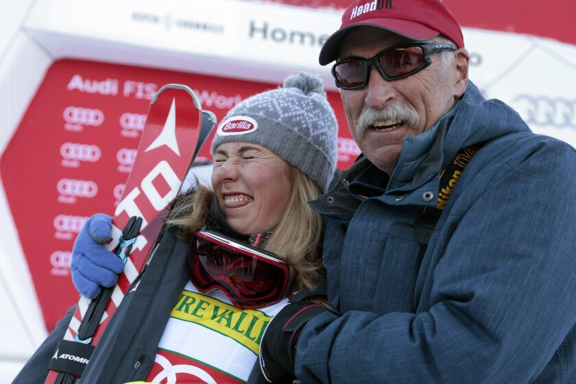 FILE - In this Nov. 28, 2015, file photo, first-place finisher Mikaela Shiffrin, left, poses with her father Jeff Shiffrin after the women's World Cup slalom ski race in Aspen, Colo. Not a day goes by that some image, moment or even song doesn't remind two-time Olympic gold medalist Mikaela Shiffrin of her dad, Jeff, who died February 2020, after an accident at his home in Colorado. (AP Photo/Nathan Bilow, File)