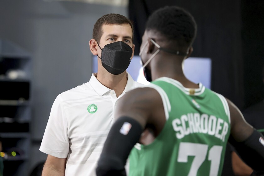 Brad Stevens, Boston Celtics President of Basketball Operations, speaks with Dennis Schroder at the Boston Celtics Media Day, Monday, Sept. 27, 2021, in Canton, Mass. (AP Photo/Mary Schwalm)