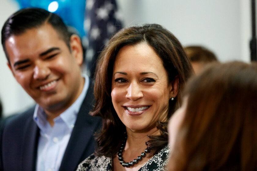 Senator-elect Kamala Harris, center, speaks with Long Beack Mayor Robert Garcia, left, and Angelica Salas of the Coalition for Humane Immigration Rights of Los Angeles during a meeting with immigrant families and activists on Nov. 10.