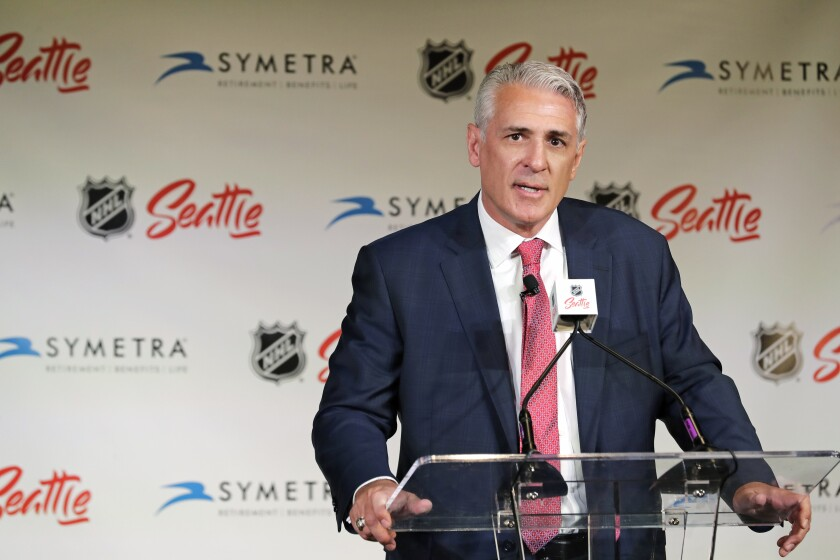 """FILE - In this Thursday, July 18, 2019 file photo, Ron Francis talks to reporters in Seattle after he was introduced as the first general manager for Seattle's yet-to-be-named NHL hockey expansion team. Four years since George McPhee was a """"puppet master"""" of the NHL leading up to the Vegas expansion draft, general managers approached this trade deadline with Seattle's upcoming addition to the league in mind. While Kraken GM Ron Francis prepares – and maybe made a handshake deal or two already like McPhee did – Seattle was on his colleagues' minds.(AP Photo/Ted S. Warren, File)"""