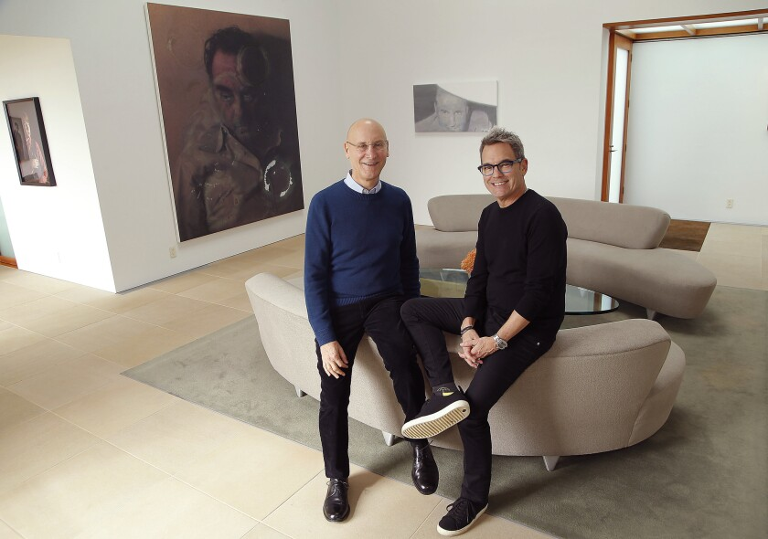 Los Angeles collectors Alan Hergott, left, and Curt Shepard announced a major donation to MOCA. They sit before works by Rudolf Stingel and Luc Tuymans in their Beverly Hills home.