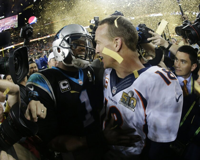 Denver Broncos' Peyton Manning, right, greets Carolina Panthers' Cam Newton (1) after the NFL Super Bowl 50 football game Sunday, Feb. 7, 2016, in Santa Clara, Calif. The Broncos won 24-10. (AP Photo/Julio Cortez)