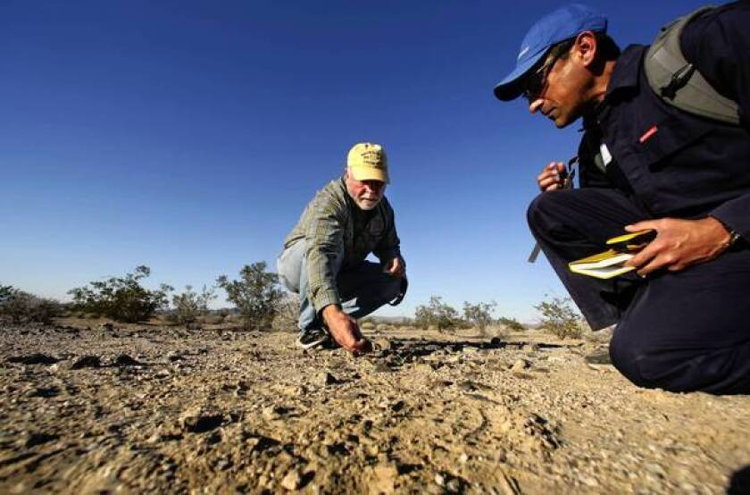 Molecular biologist and entrepreneur J. Craig Venter, left, and microbiologist Gerardo Toledo collect microbe samples at Mojave National Preserve. Venter is field-testing technology he says will revolutionize the search for extraterrestrial life.