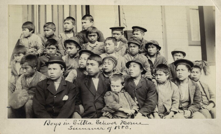 """Students appear in a photograph with an inscription reading, in part, """"summer of 1883"""""""