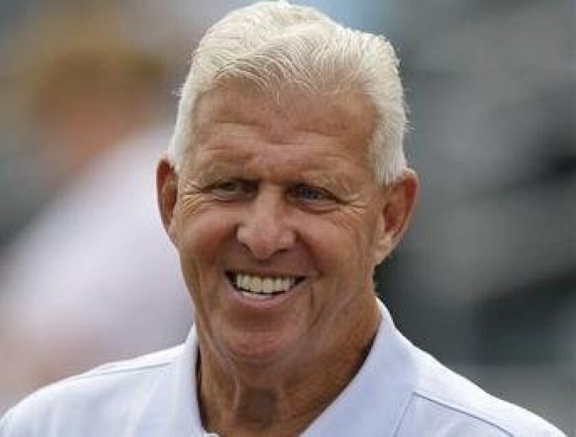 FILE - This March 30, 2012 file photo shows retired NFL football coach Bill Parcells watching batting practice before a spring training baseball game between the New York Mets and the St. Louis Cardinals in Jupiter, Fla. The NFL upholds its punishment of the Saints stemming from the team's bounty s